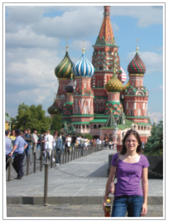 Aimee Fausser stands over Moscow's Red Square, overshadowed by the towering icon of St. Basil's Cathedral.